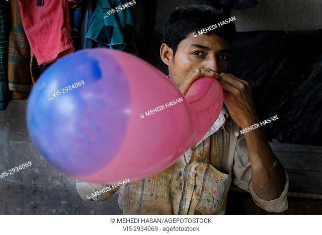 Bangladeshi child labor working in a balloon factory in Dhaka. Child labor is very common in almost every industry of Bangladesh such as Aluminum factory