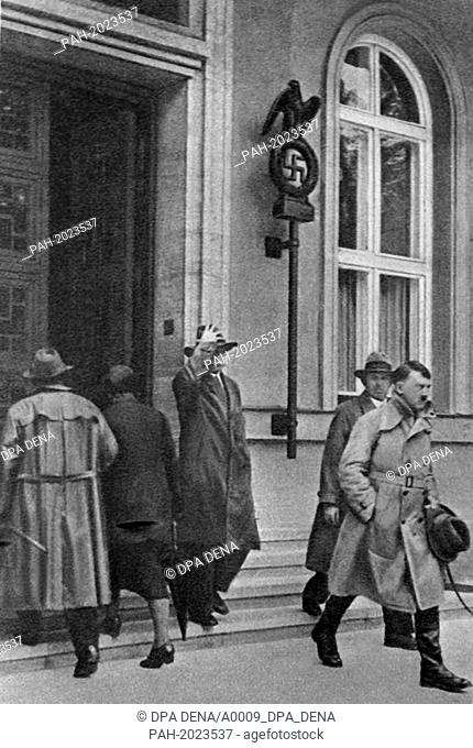 "National Socialist leader Adolf Hitler (r) leaves the party headquarters of the NSDAP, the """"Brown House"""", in Munich (undated)"