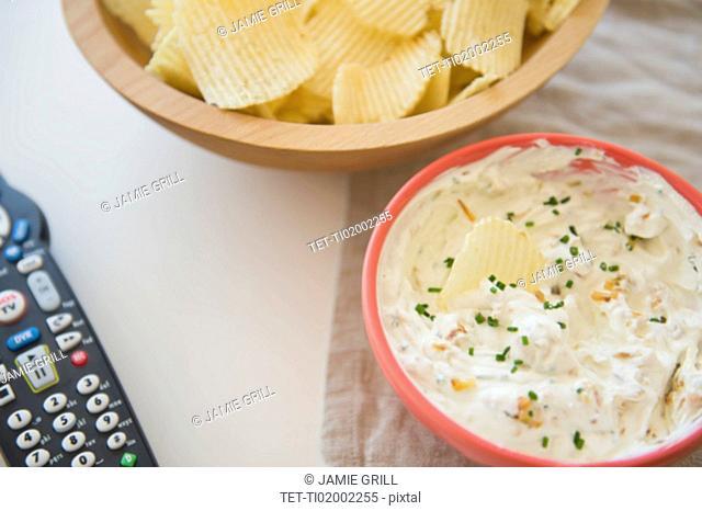 Studio shot of crisps and onion dip