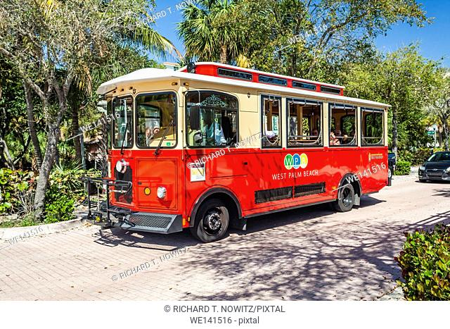 Red Tourist Trolley car offers free rides to visitors to West Palm Beach, Florida