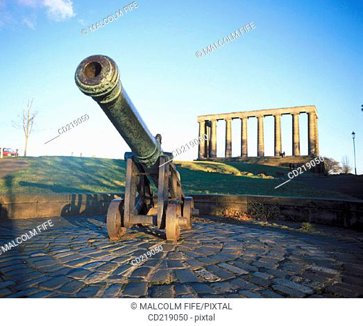 Old cannon and National Monument, replica of the Parthenon that was designed in 1822 as a memorial to the Scots who died in the Napoleonic Wars