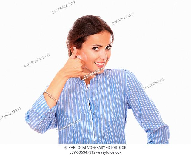 Portrait sexy hispanic woman on blue blouse with call gesture smiling at you on isolated studio