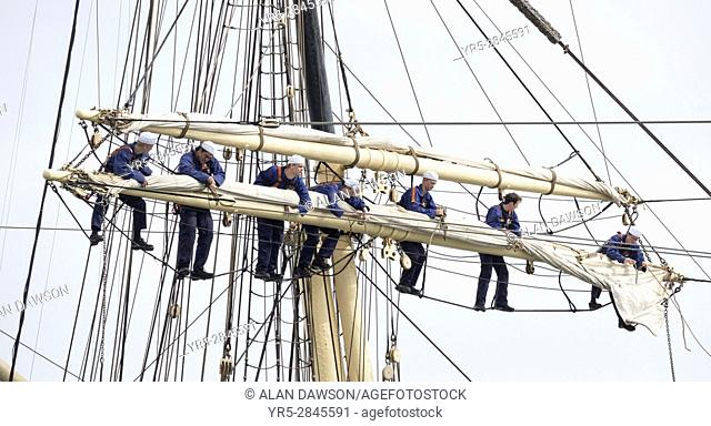 "Las Palmas, Gran Canaria, Canary Islands, Spain. 2nd March 2017. Cadets of the Danish tall ship, """"Danmark"""", climb the rigging as the ship departs Las Palmas..."