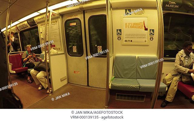 Washington DC, USA - 15 May 2015: People travel in public train metro