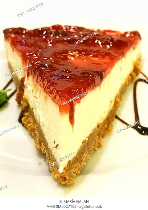 Cheese cake with strawberry jam. Close view
