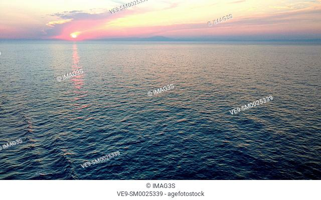 Sunset on sea, seen from a cruise boat, Mediterranean sea between France and Italy