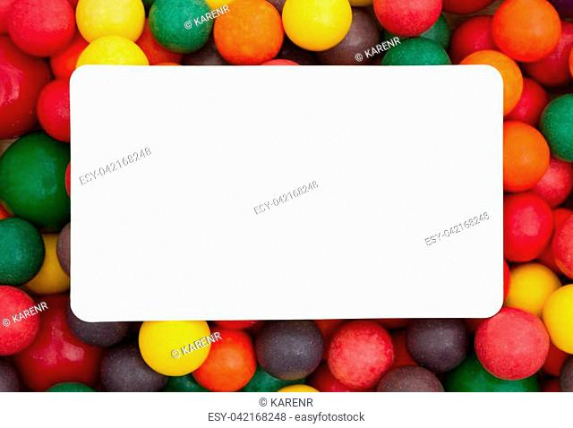 Colorful multi colored bubble gum background with white card