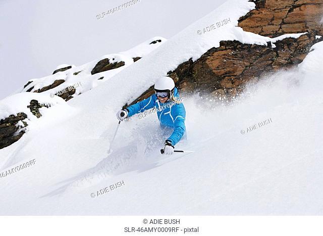 Skier coasting on snowy slope