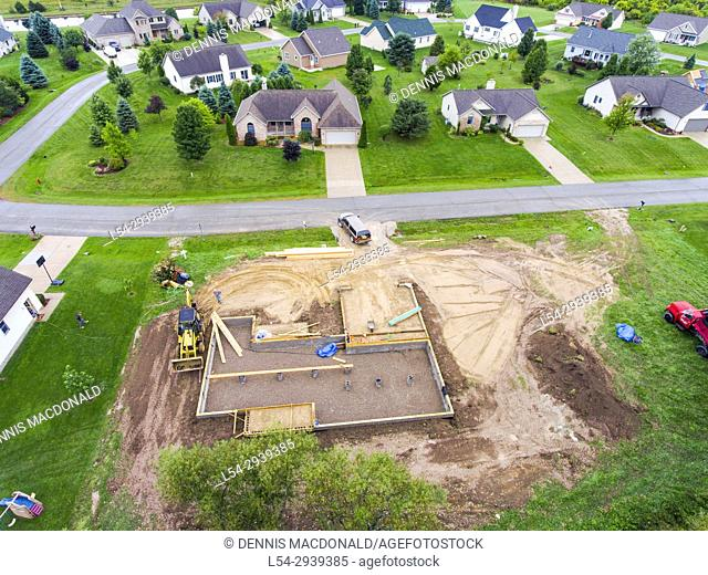 The foundation of a new home house construction in a residential neighborhood aerial view