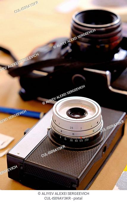 Two traditional camera's on table