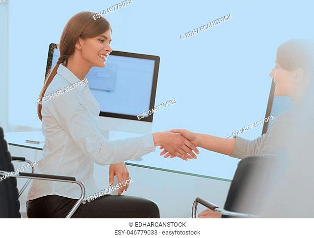 background image. business woman stretches out hand for a handshake. business background