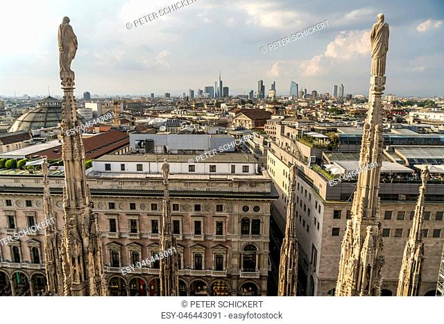 Italy, Milan, statues on Milan Cathedral and cityscape