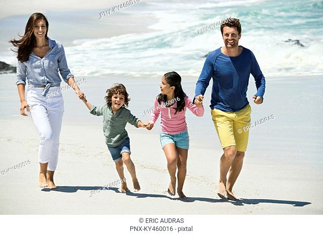 Family enjoying on the beach