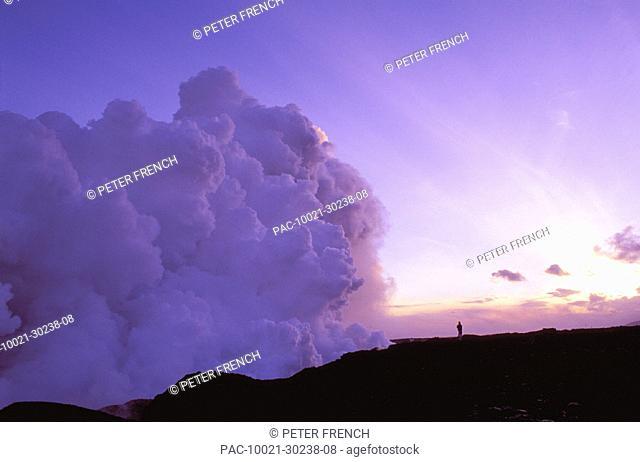 Hawaii, Big Island, Hawaii lava flow into sea, huge steam clouds in sky, sunset