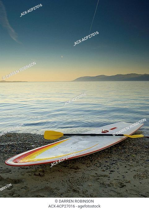 Longboard on the shore of Palm Beach near Powell River, on the beautiful Sunshine Coast of British Columbia, Canada