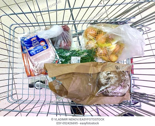 Shopping Cart With Products At The Hypermarket