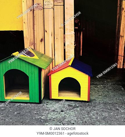 Dog houses, painted in national flag colors of Brazil and Colombia, are seen for sale on the street in Cali, Colombia, 26 June 2014