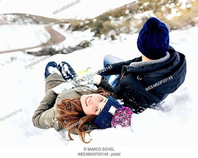 Young couple lying in the snow