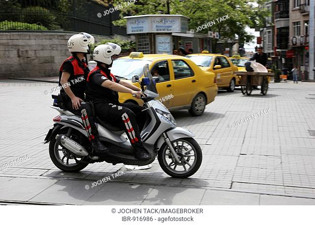 Police patrolling on a motor scooter along the shopping street Istiklal Caddesi, Beyoglu district, Istanbul, Turkey