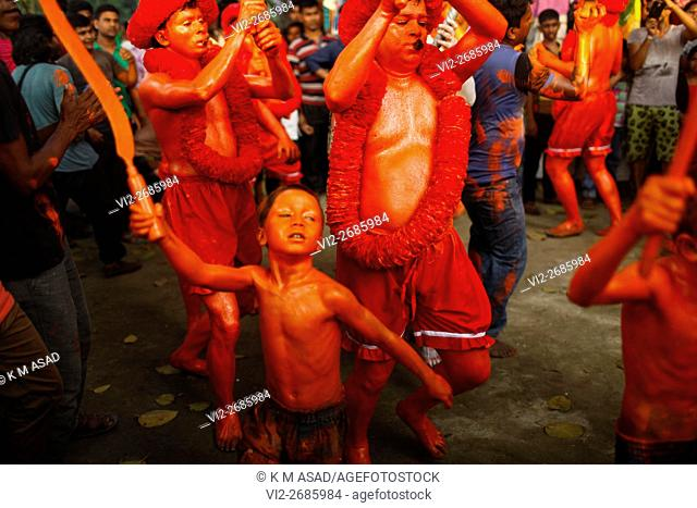 A children Hindu community devotee dances and attend as they takes part in a festival called Lal Kach (Red Glass) during the last day of the Bangla month in...