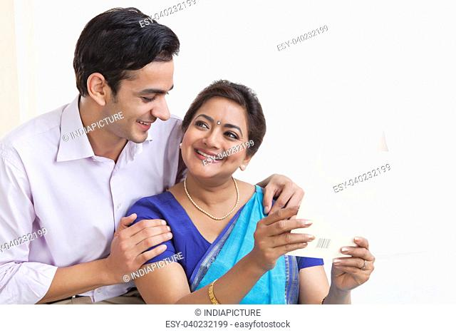 Mother and son with greeting card