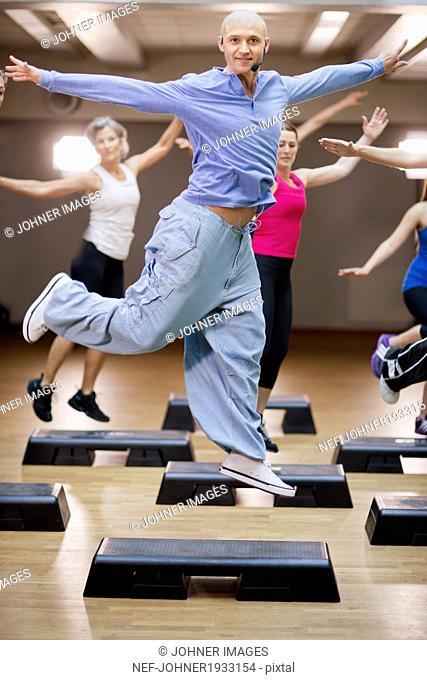 Happy young man at aerobics classes