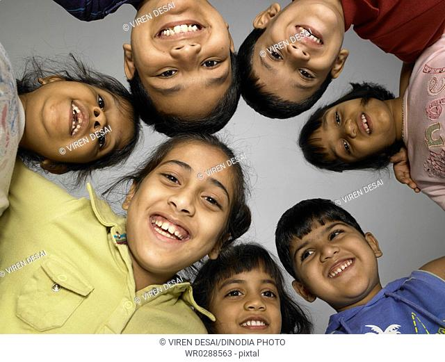 South Asian Indian boys and girls looking at camera in nursery school MR