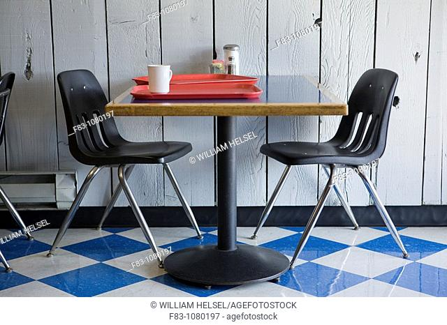 USA, Oregon, Coos County, Coos Bay area, table, chairs and trays in restaurant, Charleston Harbor, September