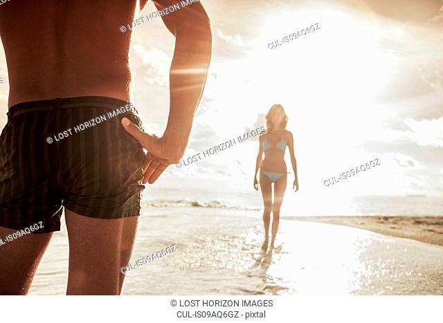 Couple on beach, Ari Atoll, Maldives