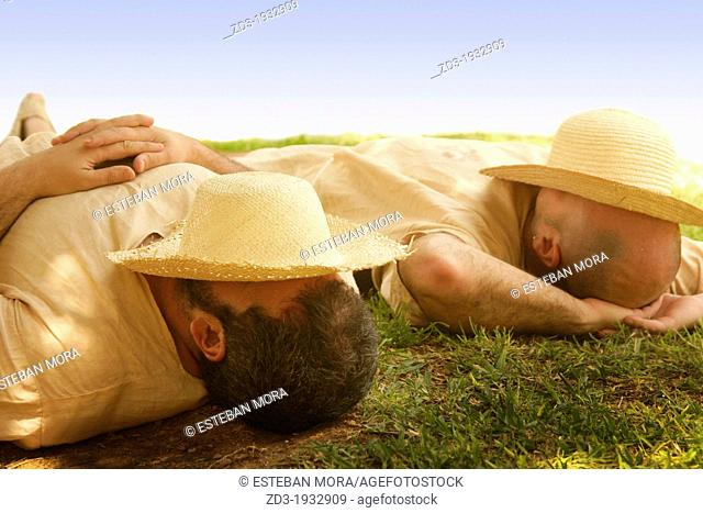 Two men in sleeping during siesta time in Valencia, Spain