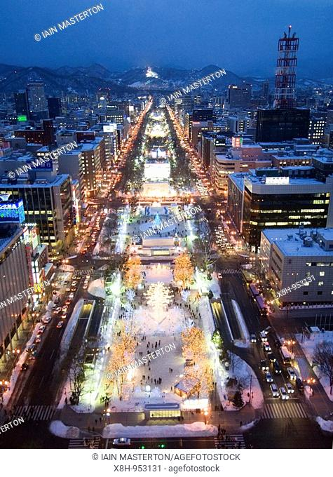 Evening view of illuminated Odori Park during winter snow festival in Sapporo Japan