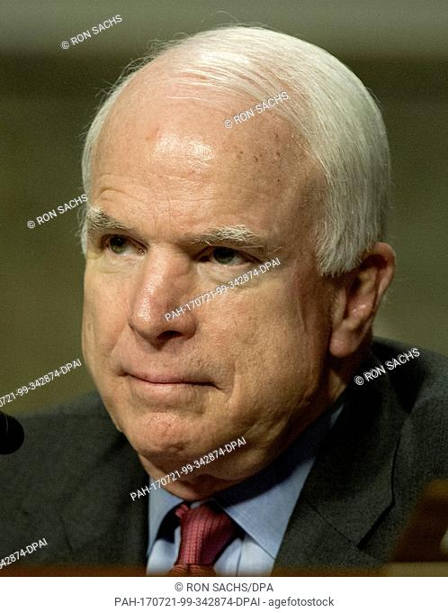 United States Senator John McCain (Republican of Arizona), Ranking Member, U.S. Senate Armed Services Committee, listens as General John R