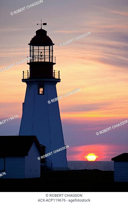 Point Riche Lighthouse at sunset. The lighthouse is located at the Port au Choix National Historic Site, Port au Choix, Newfoundland, Canada