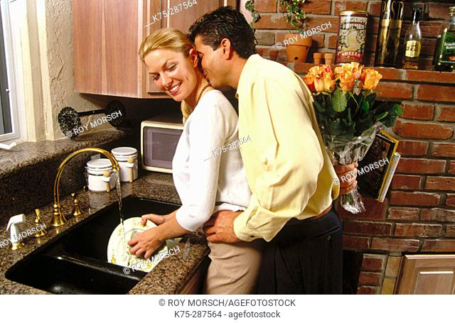 he surprises her with flowers while she's doing dishes
