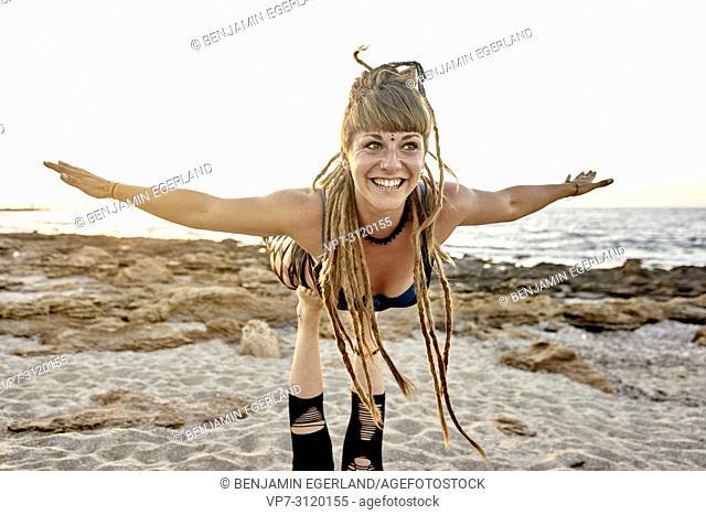 Yoga exercises in beach, Aerial Yoga, in holiday destination Chersonissos, Crete, Greece