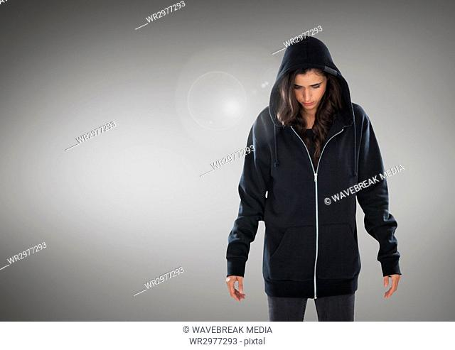 Woman hacker in front of grey background