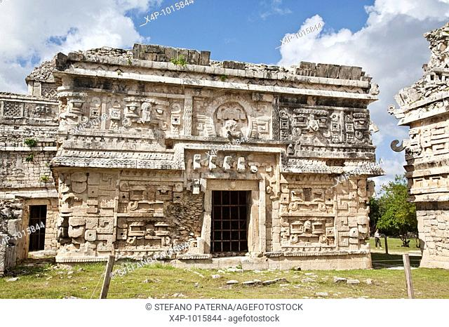 This decorated facade pertains entirely to the eastern entrance of the Annex of the Nunnery  Notable are the long-nosed masks of the god Chaac  Chichen Itza...