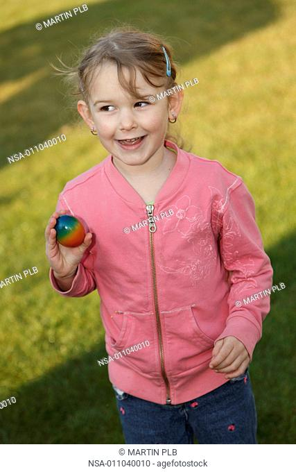 girl is happy after finding Easter egg