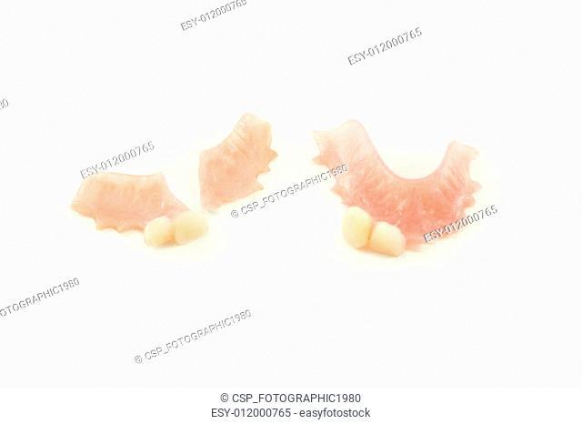 broken denture and perfect denture