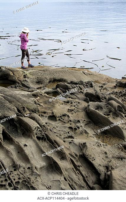 Woman on Seashore at Isle-De-Lis Marine Park, located on Rum Island, off Sidney, British Columbia, Canada