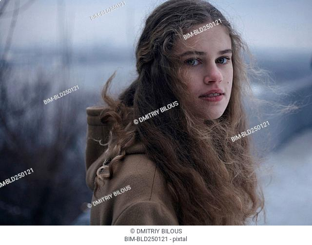 Portrait of wind blowing hair of serious Caucasian teenage girl