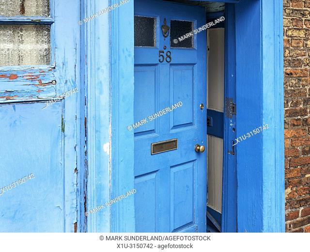 A blue door slightly ajar in Ripon Yorkshire England
