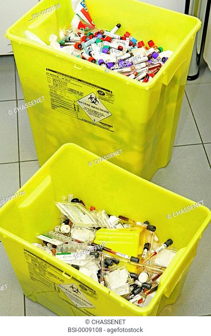 Photo essay from laboratory. Wastes : tubes, gloves, tips, pipettes ...etc Compulsory trash can for organic wastes, bound to incineration according to GBEA Good...