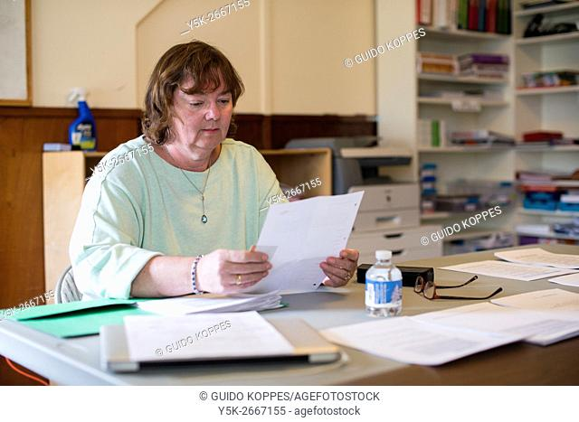 Harrison, New York, USA. Female teacher in Dutch Language and Culture preparing her lessons for her Dutch students