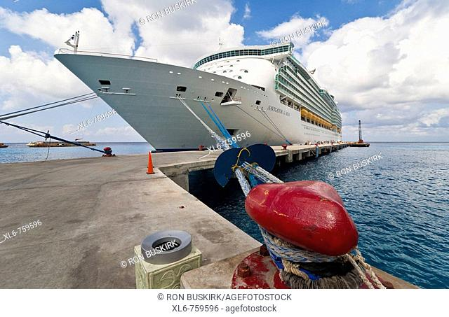 Cruise ship tied to bright red bollard on dock in Cozumel, Mexico