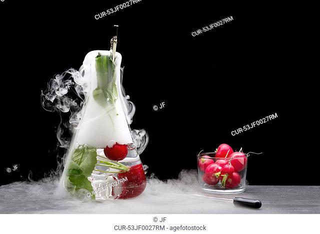 Tomatoes with fruit in smoking beaker