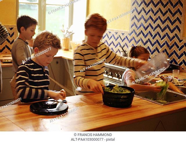 Children in kitchen, blurred