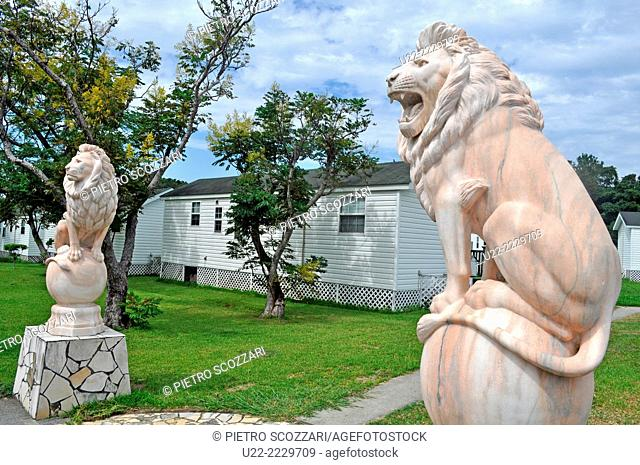 Chatan, Okinawa, Japan: cheesy lions at the entrance of a residential complex