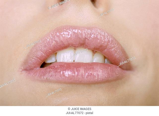 Close-up of a young woman's mouth