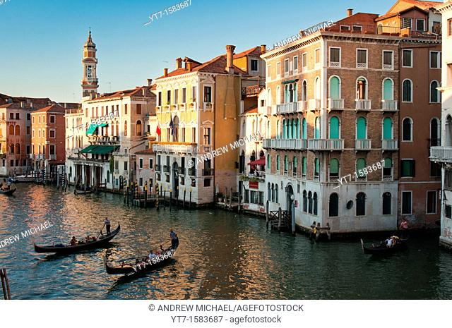 Venice Canal with gondolas at sunset  Italy